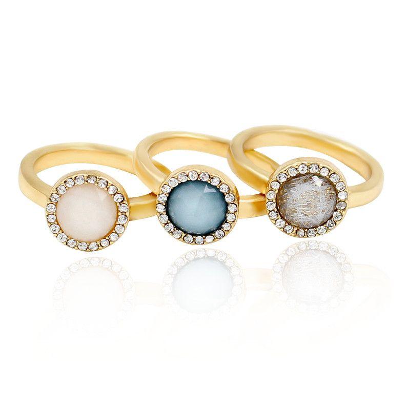 "Bella. Set of 3 sparkling faux gemstones on gold coloured bands. Band width: 0.2cm (.1""). Stone diameter: 0.9cm (.4"") . Size: UK-O / US-7."