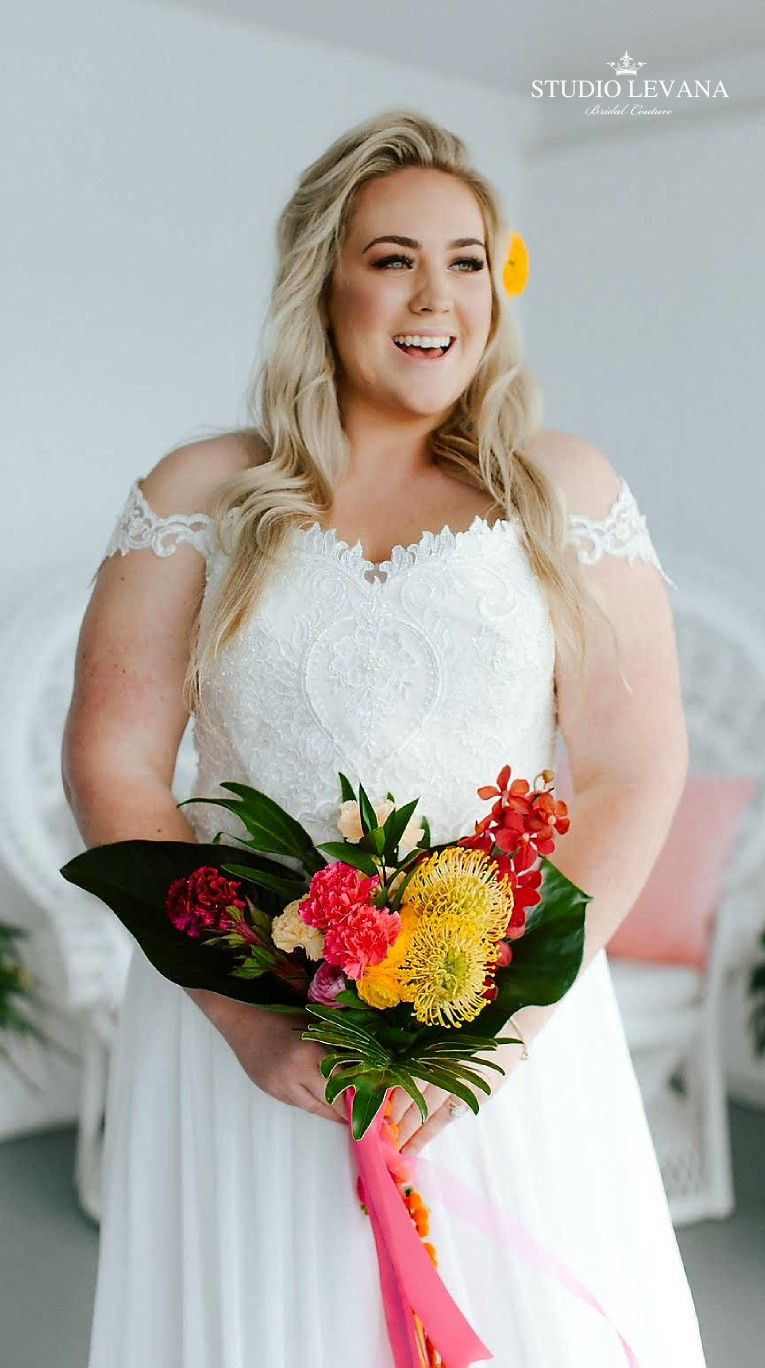 Plus size wedding gown with off shoulder straps. Valentina