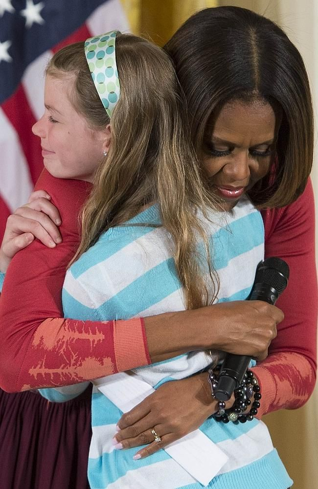 Michelle Obama hugs girl Emotional moment First Lady - michelle obama resume