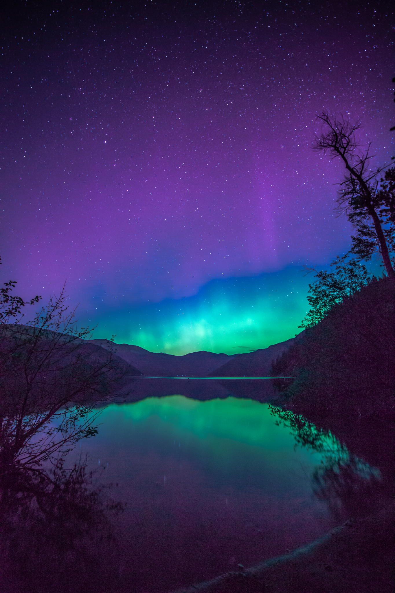 During a new moon I was fortunate to be at Christina Lake British Columbia and get a touch of the northern lights reflecting on the lake.