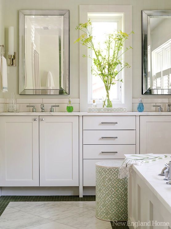 White Bathroom Cabinets And White Countertops A Slim White Tiled