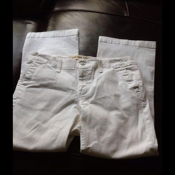 Gap denim Capri White denim low rise stretch denim.  Side slits on bottom of pant legs. Great condition GAP Jeans Ankle & Cropped