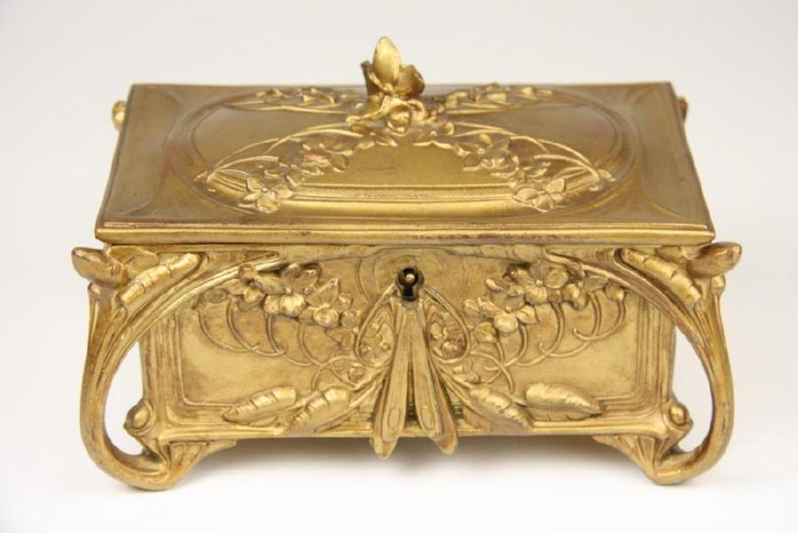 An Art Nouveau jewellery box circa 1930 standing on stylized