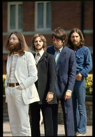 The Beatles preparing to take the famous Abby Road picture.