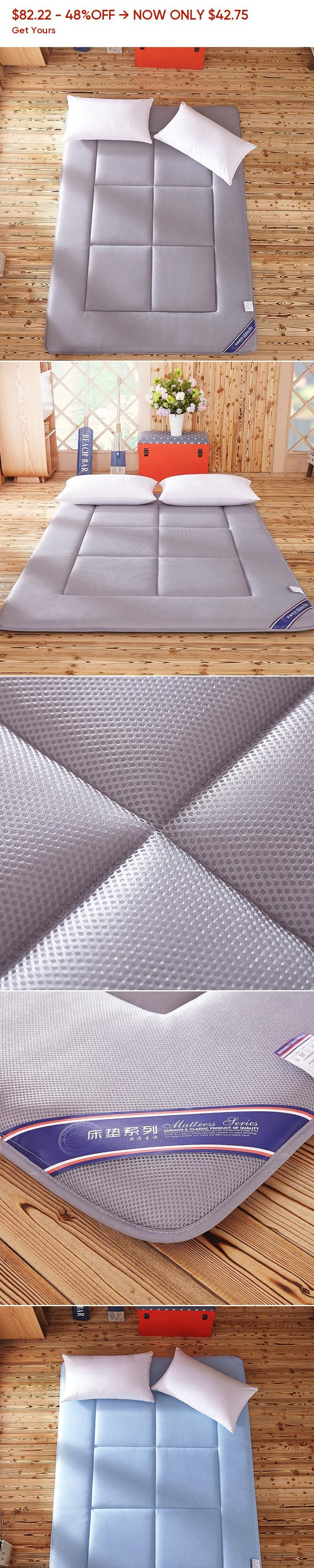 The tatami mattress pad folded back on the floor 1.8 1.5m