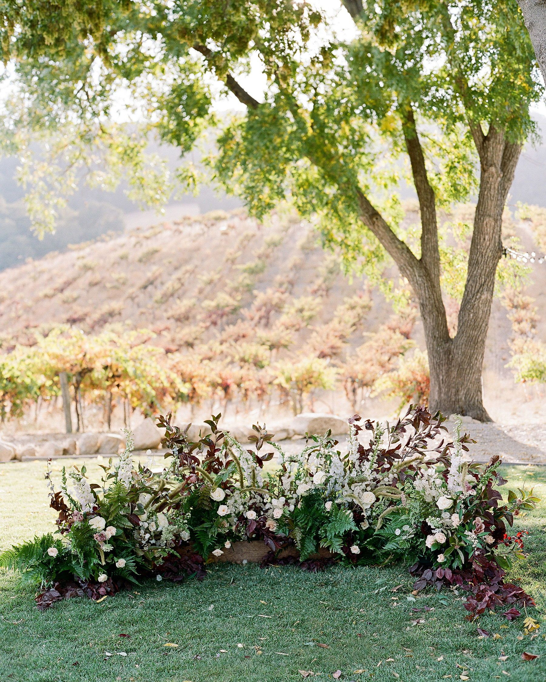 A Wedding Ceremony Trend We Re Loving Grounded Floral Arches Wedding Arch Wedding Ceremony Arch Floral Arch