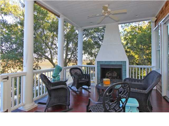 Cozy Screened porch with a fireplace at 17 Seagrass Ln, in #WildDunes #SC dunes properties www.dunesproperties.com