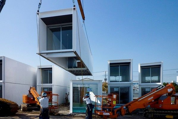 Assembling The Bayside Marina Hotel designed by Yasutaka Yoshimura Architects and constructed from shipping containers.