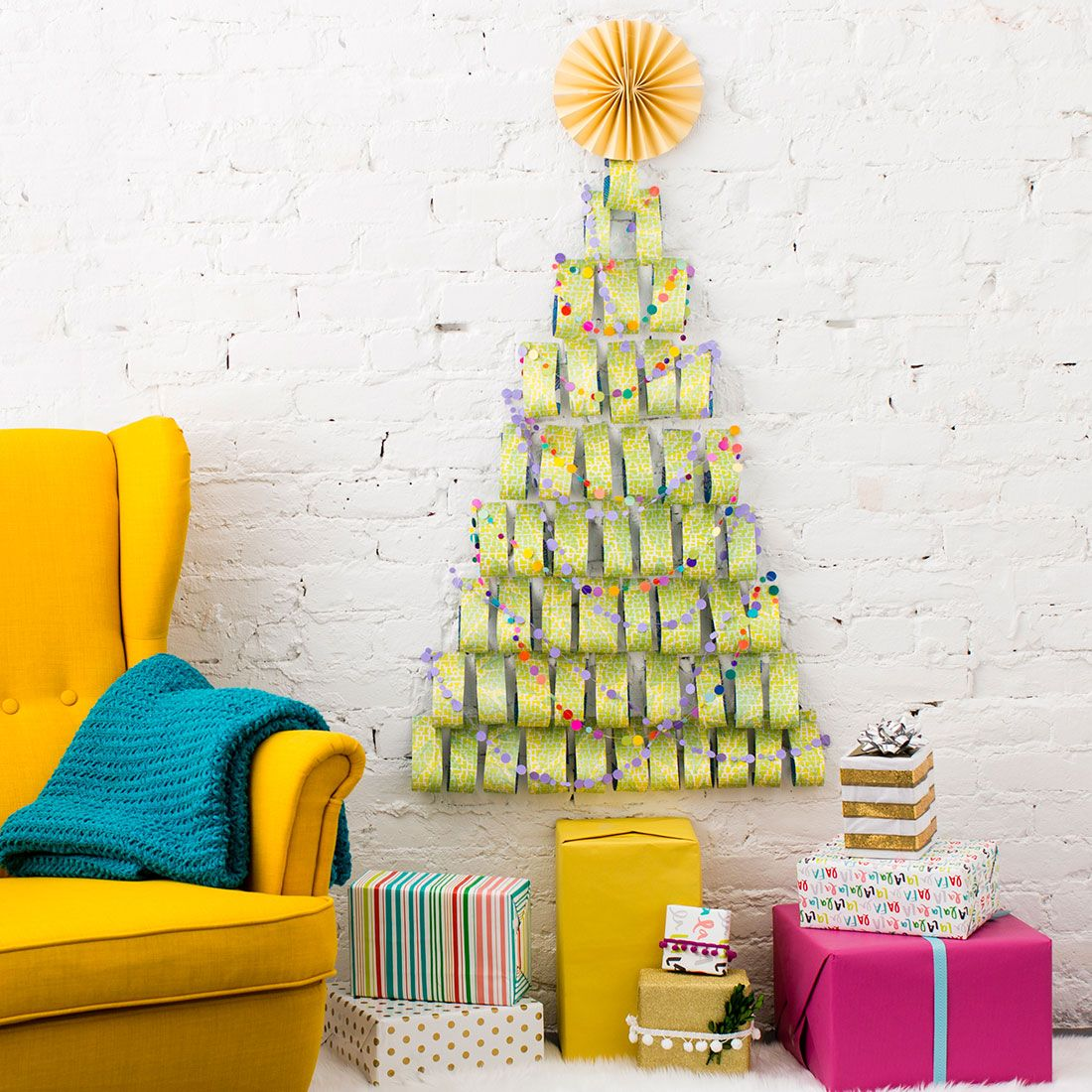 Short on space? Use wrapping paper to make this Christmas wall tree ...