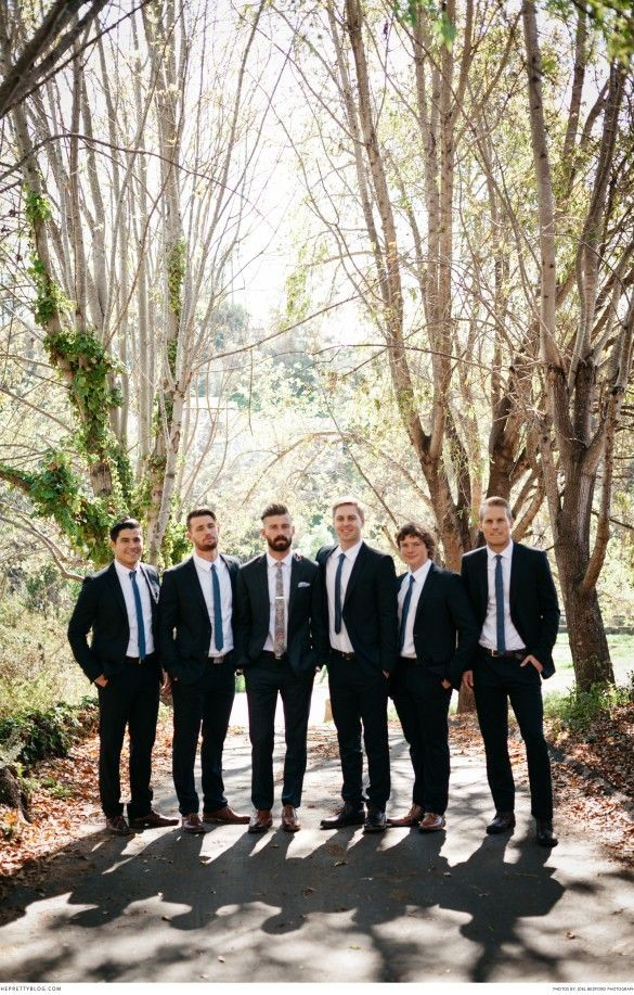 Classic black suits and an accent floral tie | Photograph by Joel Bedford | Real weddings