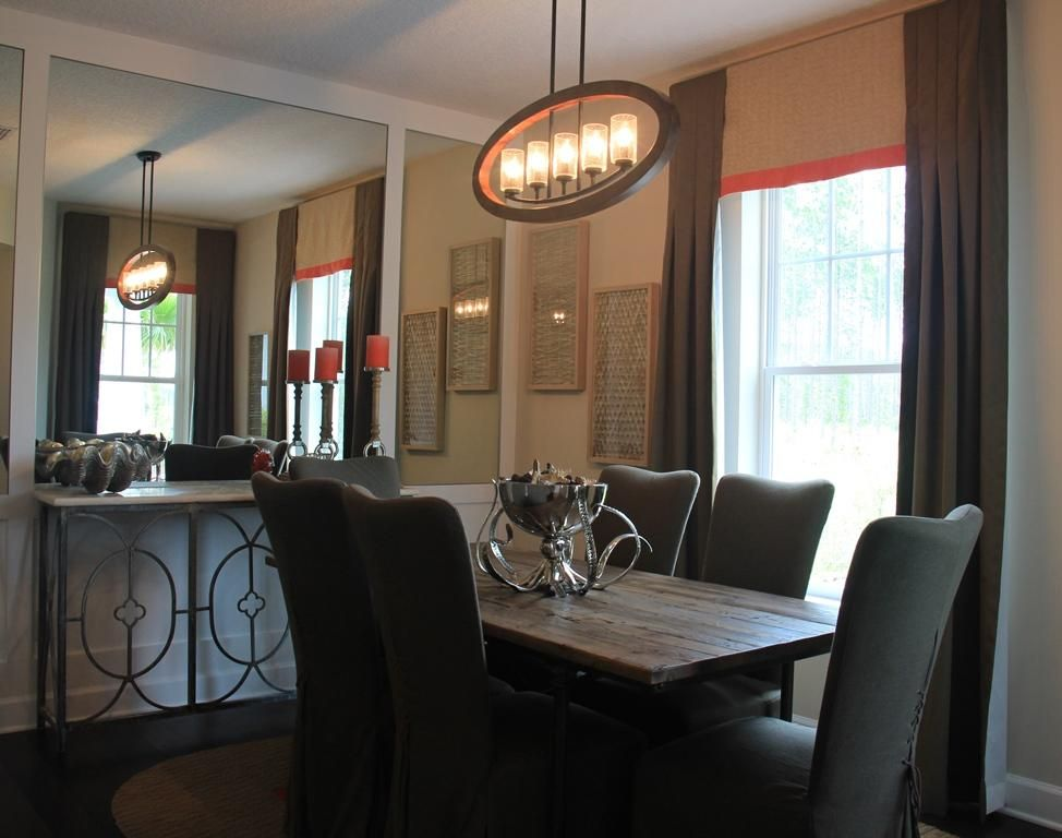 Bring Some Light Into Your Dining Room With A Fashionable Lighting Fixture Above Table
