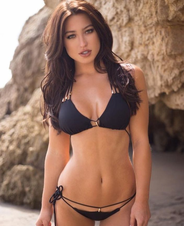 With her slim body and Black hairtype without bra (cup size D) on the beach in bikini
