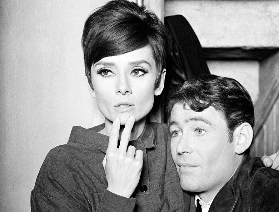 Audrey Hepburn and Peter O'Toole photographed by Terry O'Neill on the set of How to Steal a Million, Paris, France, 1965.