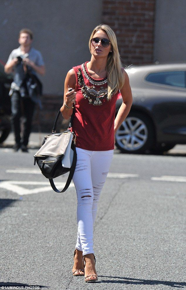 f677411ae38a Alex Gerrard in a pair of pin-showcasing white ripped jeans with studded  stilettos