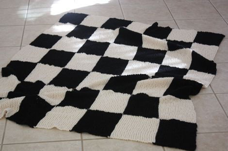 I love this blanket. It makes me want to learn to knit. But then that feeling passed, and I'm wondering if I can buy one somewhere.