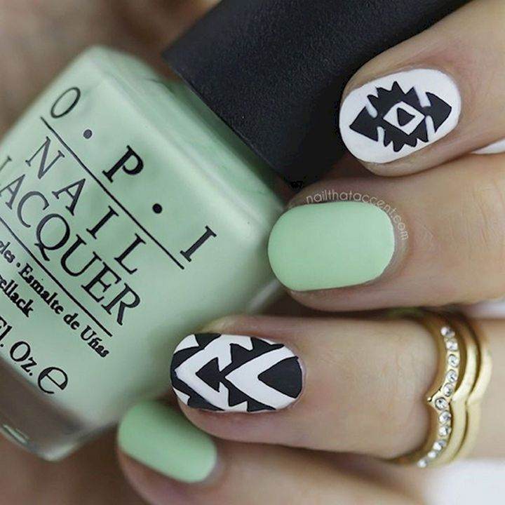 18 Beautiful Green Nails for Fall - A beautiful shade of green with white and black accent nails.