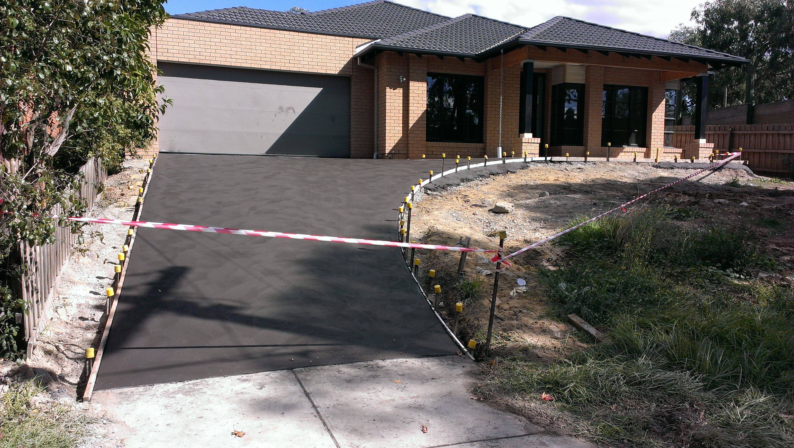 Charcoal Colour Stipple Finish Driveway On A Hill