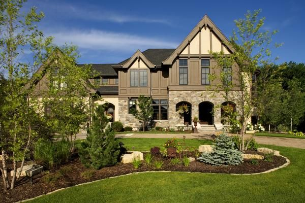 Garden Ideas For Minnesota front yard landscaped bed built on a berm with boulders, stone