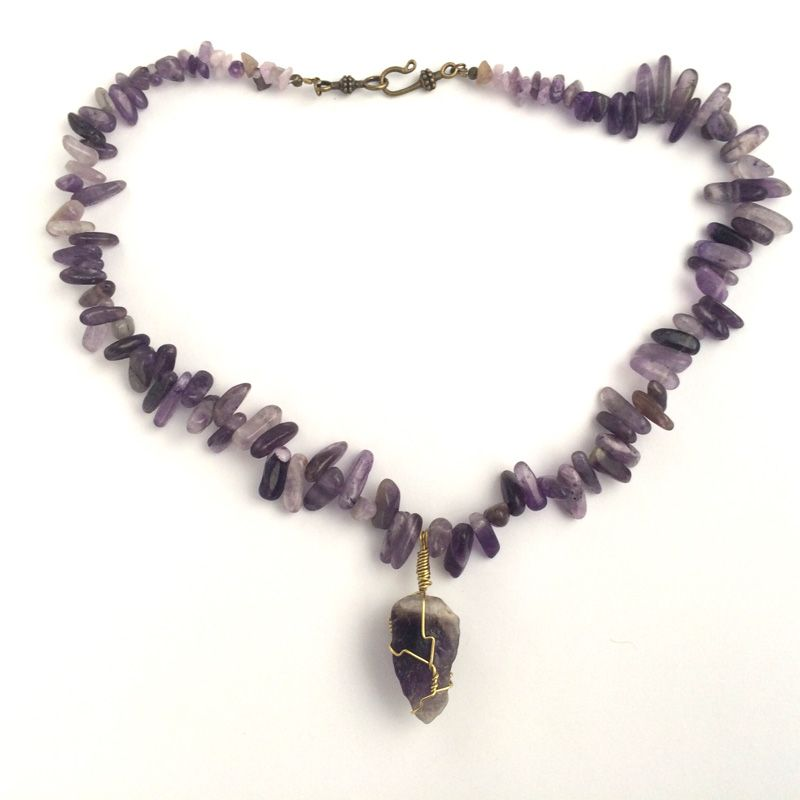 Adonia, meaning 'beautiful lady' in Greek, is a stunning statement necklace with sediment jasper and amethyst gemstones. The necklace is approximately 20″ and features an amethyst quartz centrepiece (approximately 1.5″) and bronze hook clasp.