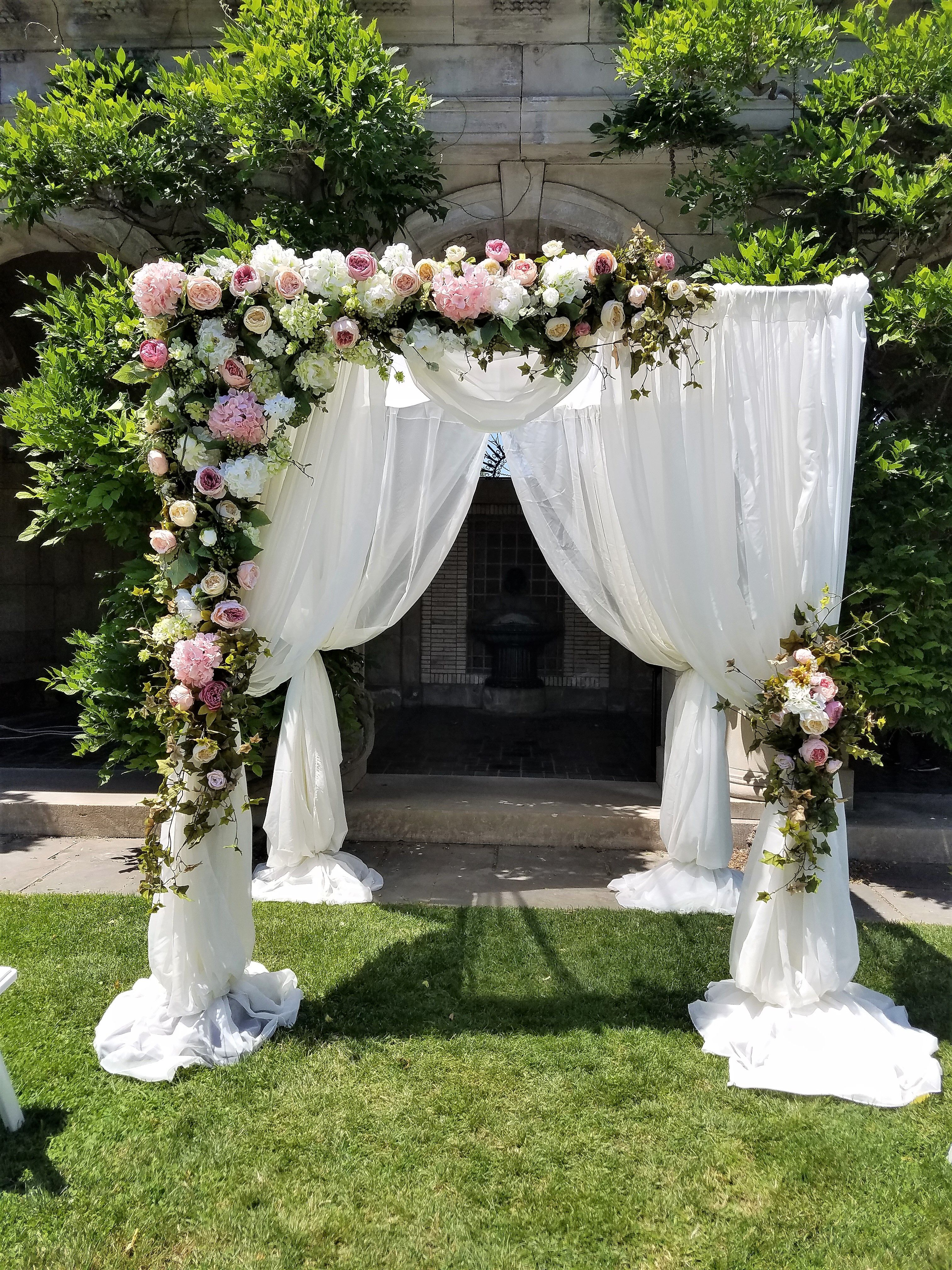 Wedding decorations arch  Shades of blushes pinks and ivory for this ChuppahArch wedding