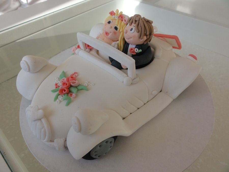 wedding cake fondant toppers 2 layer wedding cake in pink and white topper car with 22694