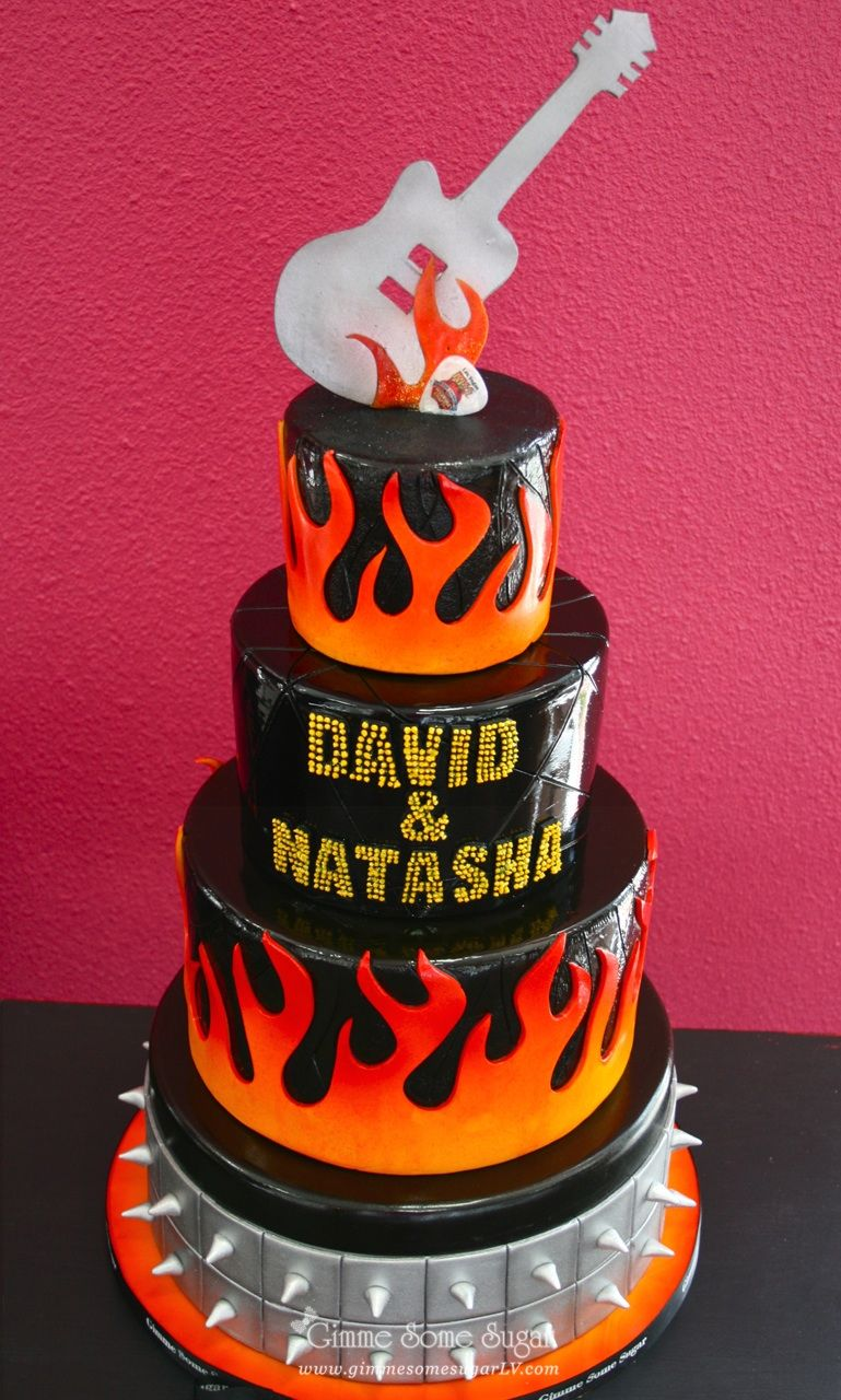 Kiss themed rocker inspired wedding cake complete with flames