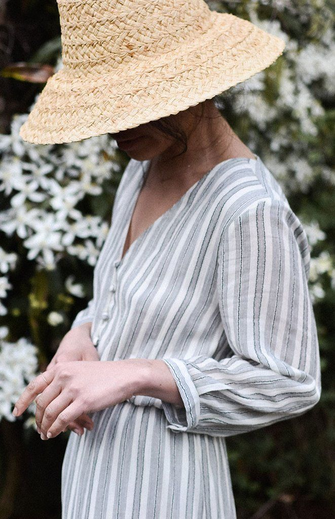 Vintage inspired dress with dark charcoal grey stripes against off white. This feminine dress comes in a soft lightweight cotton and features long 3/4 length puff sleeves, elastic waist, yoke along th