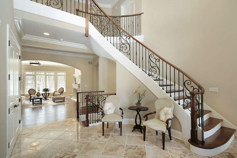 Narrow Foyer Stairs : Marble floor and narrow stairs with wrought iron posts in the