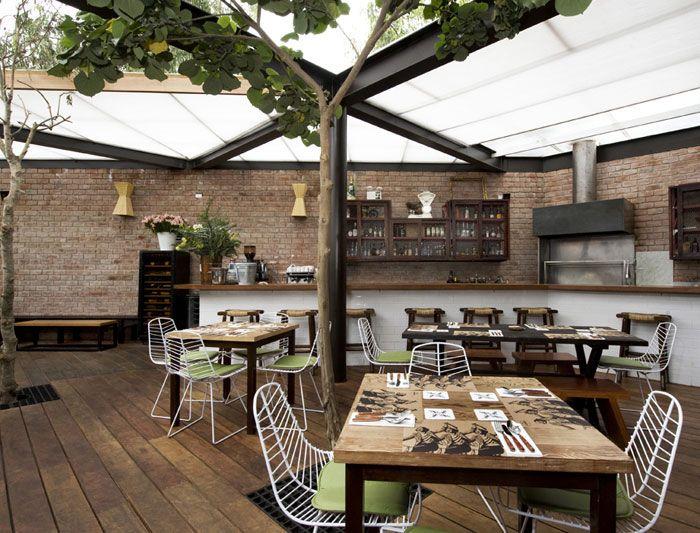 Restaurant with large open garden interiorzine chairs