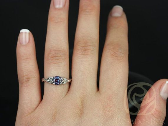 This engagement ring is a Celtic knot inspired design. It is simple yet unique…