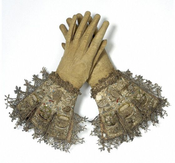 Gloves with gauntleted cuffs elaborately embroidered with animals and seed pearls, with delicate cream kidskin fingers.    Pair of gloves  museum number 1506-1882
