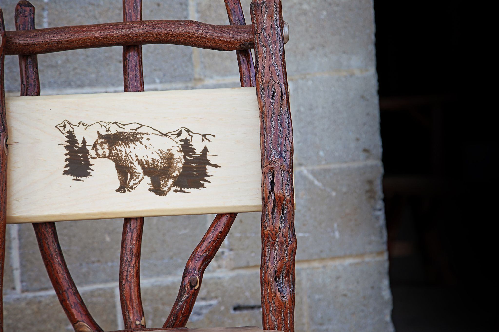 Log chair with bear engraving from Peaceful Valley Furniture