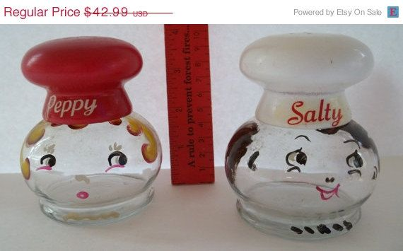 Hand painted salt and pepper shaker set. Hand wash with