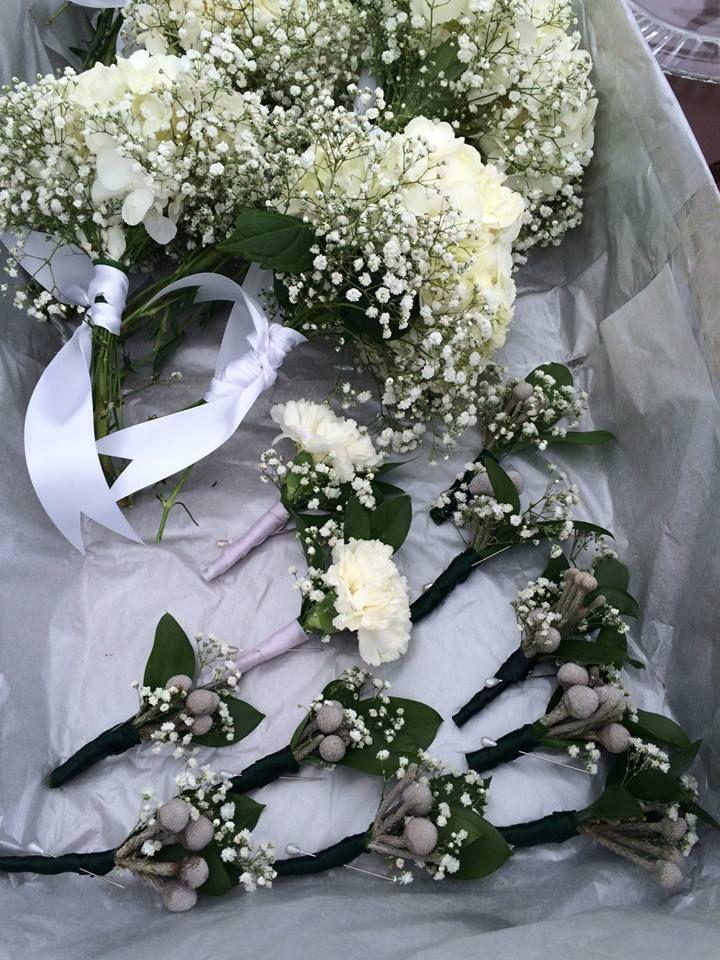Brides maids bouquets white hydrangeas with babies breath