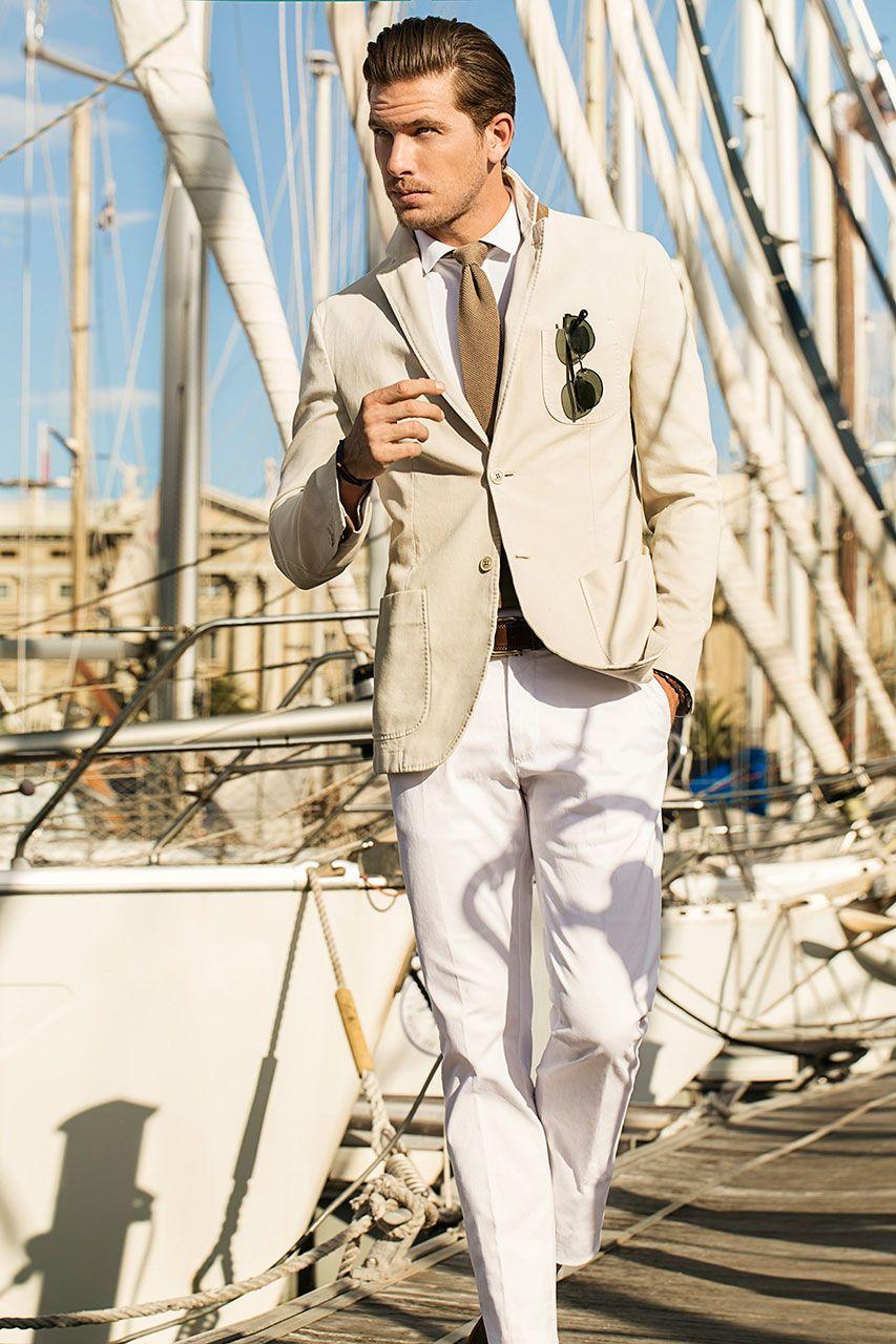 Beige jacket blazer sport coat on white shirt and white pants ...
