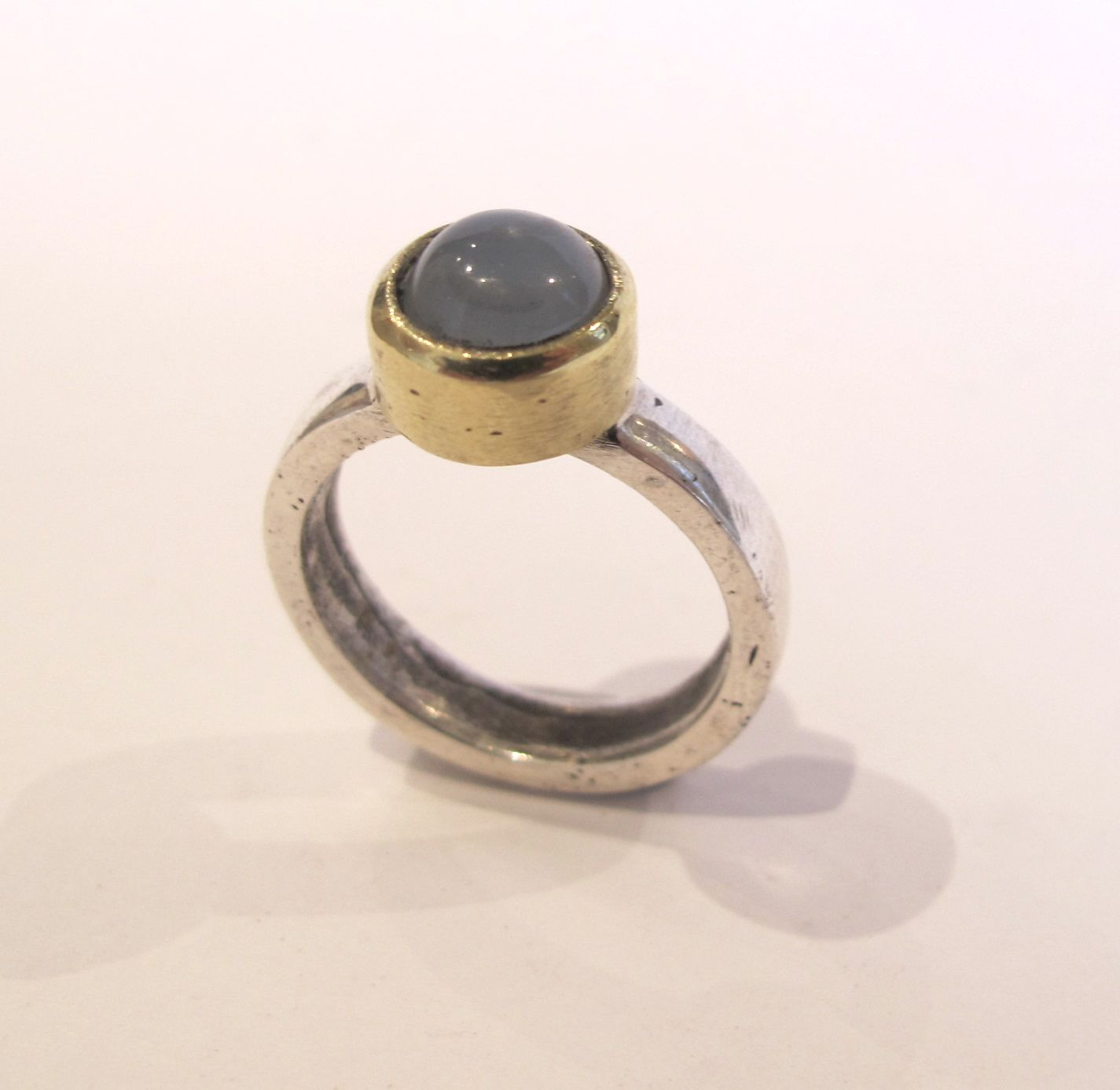old silver, brass & moonstone ring