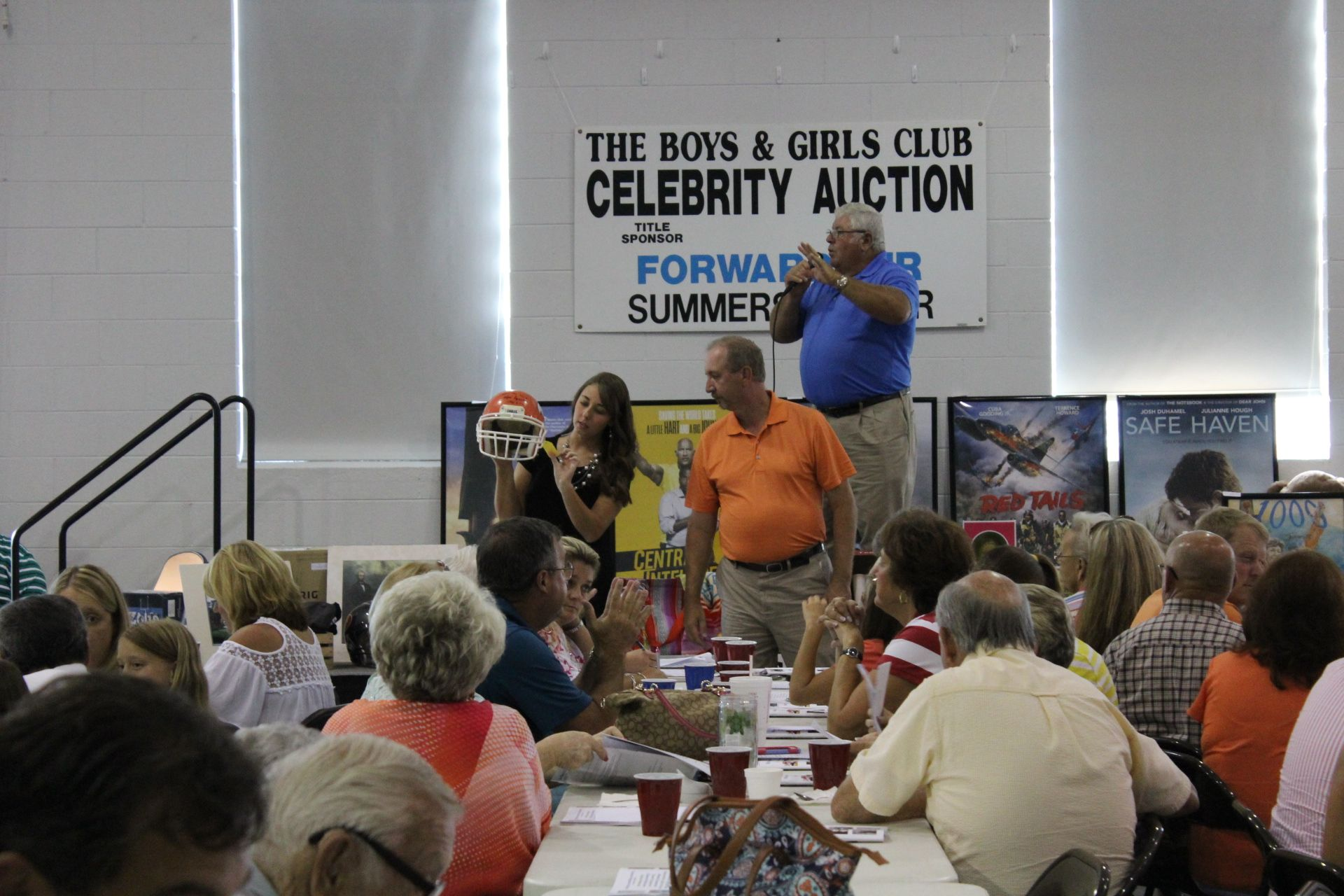 Eddie Yokley works for bids on this autographed football helmet from ken Sparks of Carson Newman during the Boys & Girls Club celebrity Auction held in August 2016 at Trinity United Methodist Church in Greeneville, Tennessee