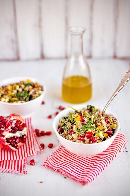 {Quinoa salad with pomegranate, spinach and avocado.}