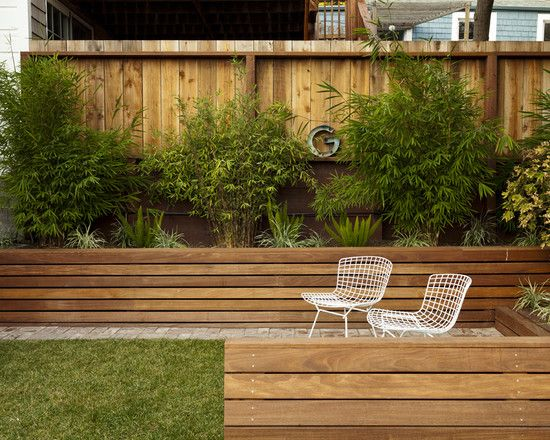 beautiful landscape exterior with wooden retaining walls and patio furniture - Timber Retaining Wall Design