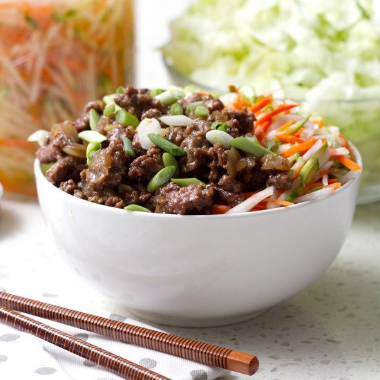This Dish Has Sweet And Peppery Ground Beef Mixed In A Bowl With White Rice Lettuce And Pickled Vegetables Beef Recipes Asian Recipes Beef