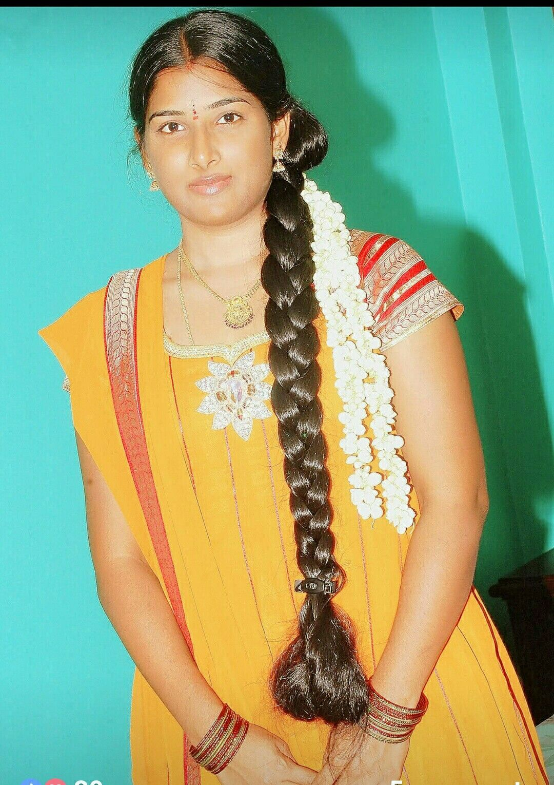 Tamil Girl Sporting A Long Hair Which Is Oiled And Neatly Braided She Also Sports Jasmine F Hair Oil Ingredients Long Hair Indian Girls Indian Long Hair Braid