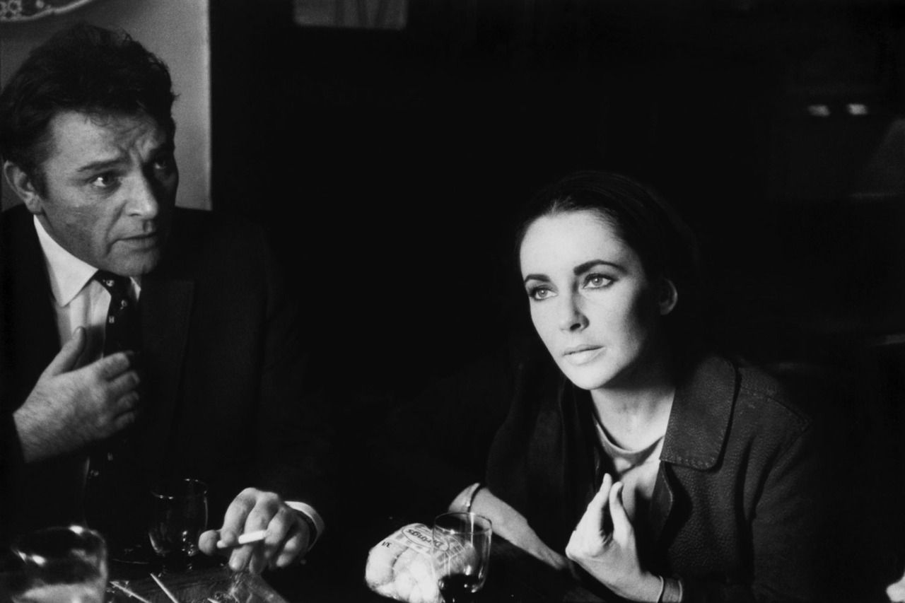 Happy Birthday Elizabeth Taylor.    Pictured, Eve Arnold's stunning portrait of Liz Taylor and Richard Burton at a local pub in Shepperton, England, where he was starring in the role of Becket.
