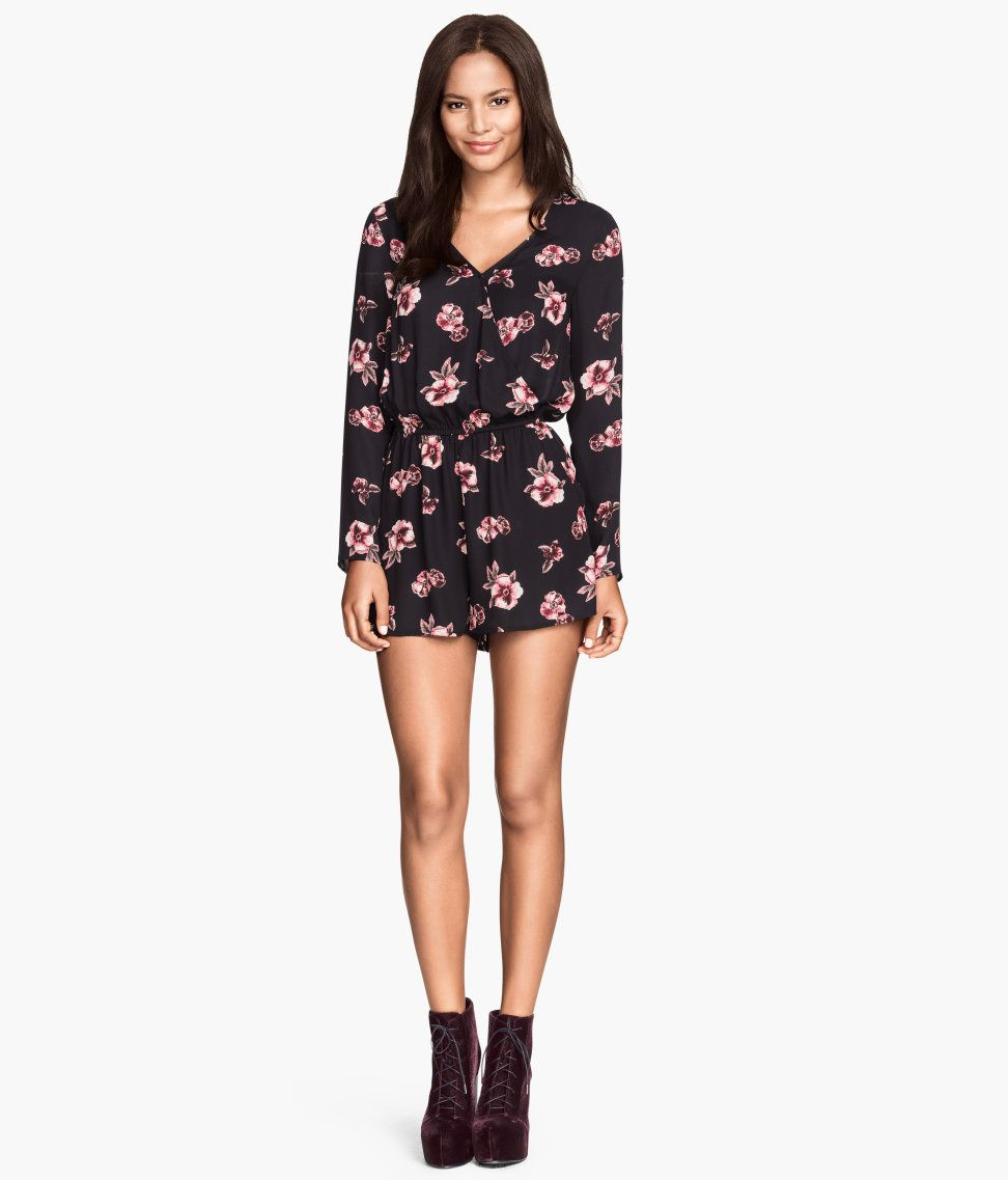 9db13f4654d4 Airy long-sleeve jumpsuit with printed black floral pattern ...