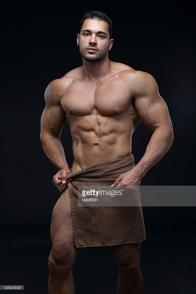 Handsome muscular male with a towel around his waist-isolated on black  background decd50c32