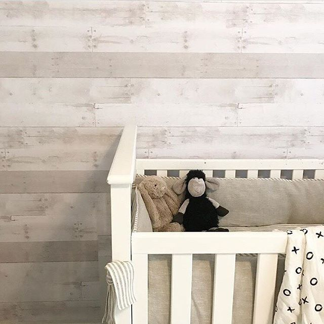 That Gorgeous White Washed Shiplap Wall It S A Peel And Stick Wallpaper Via Courtneybschultz Nursery Wallpaper Accent Wall Shiplap Nursery Ship Lap Walls
