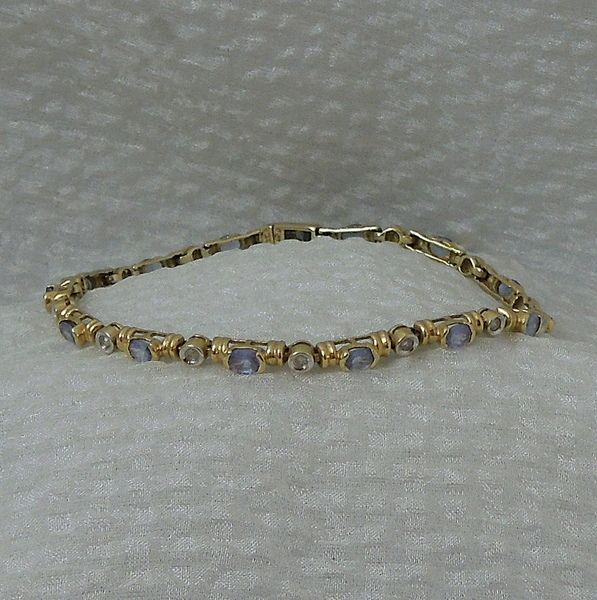 Tanzanite and Diamond Bracelet in 14k Yellow Gold, $350.