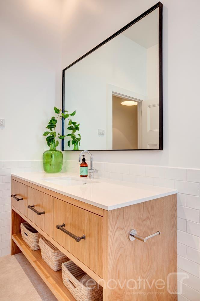 timber vanity, white top, black mirror rim, white tile