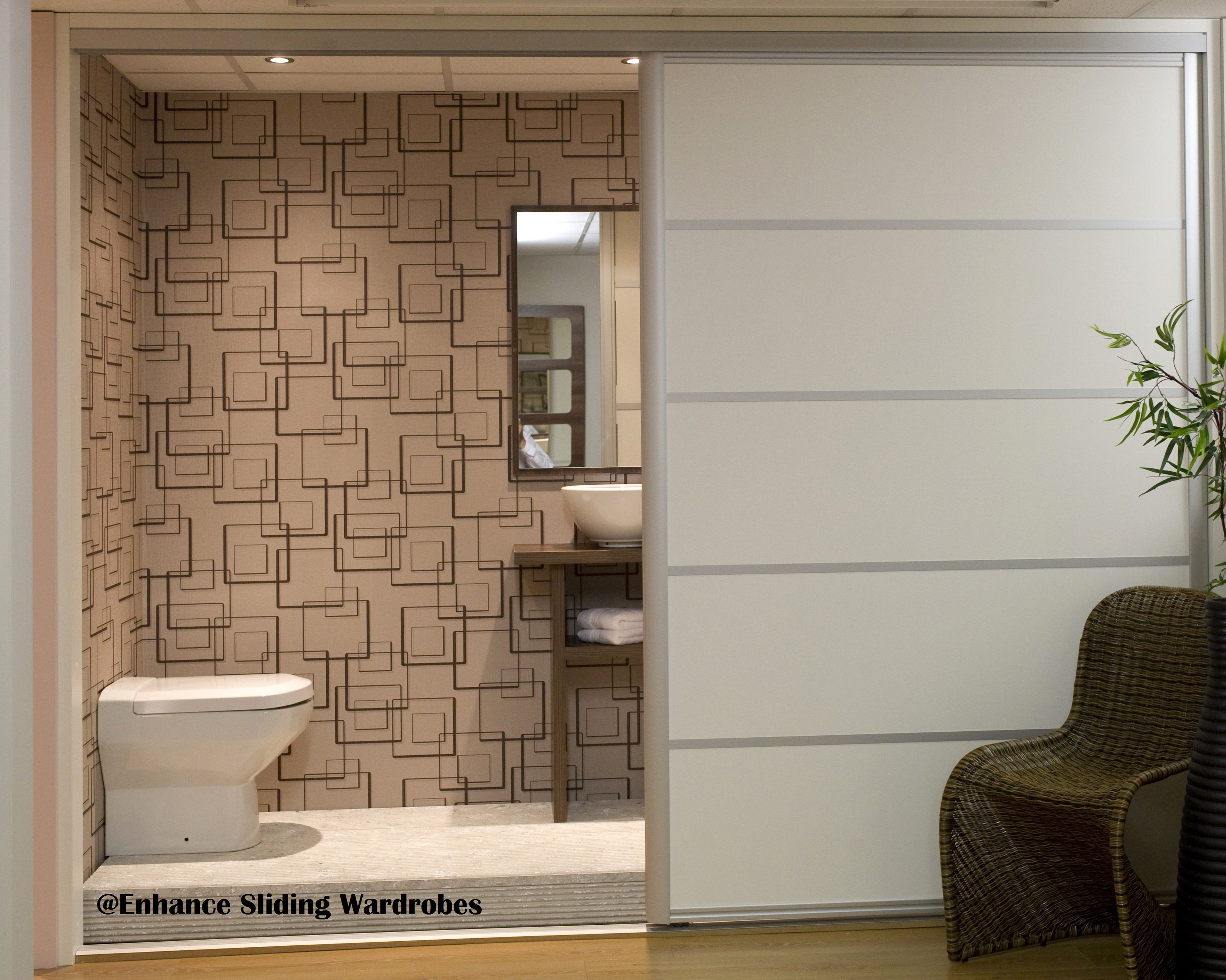 Extra wide white sliding doors used as a room divider for for Room divider for bathroom
