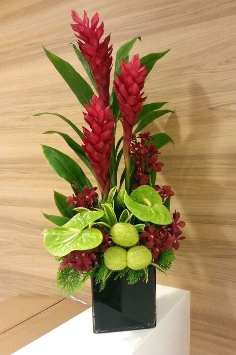 Red Ginger With Green Anthurium And Red Orchid Table Arrangement Descriptio Tropical Floral Arrangements Fresh Flowers Arrangements Church Flower Arrangements