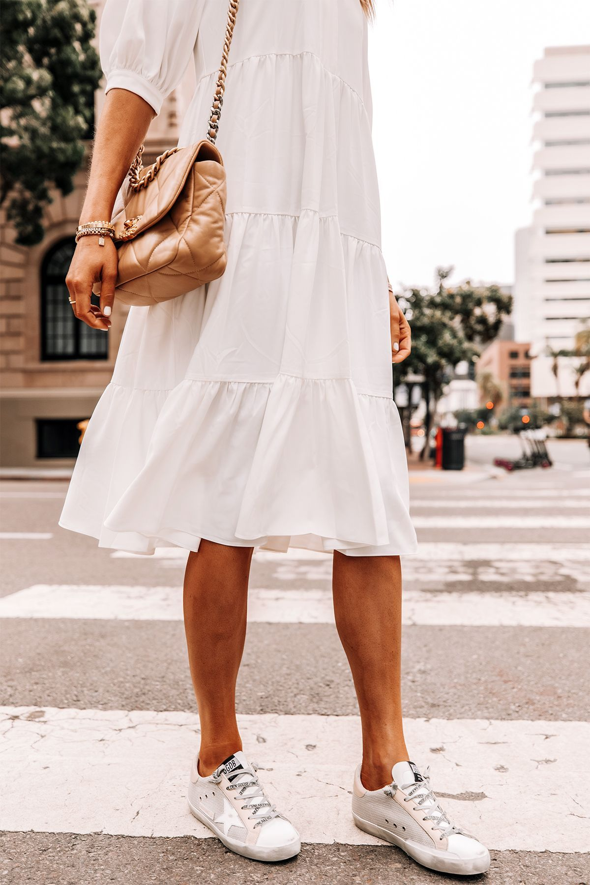How To Pull Of Wearing A White Summer Dress With Sneakers Fashion Jackson Fashion Jackson Fashion White Dress Summer [ 1800 x 1200 Pixel ]